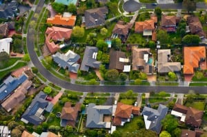 homes in suburban neighbourhood community birds eye view